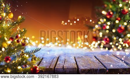 Wooden Table With Snow And Defocused Christmas Tree - Abstract Background