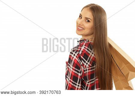 Young Attractive Woman Smiling Over Her Shoulder Holding Shopping Bags Isolated. Happy Female Custom