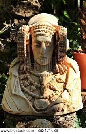 Lady Of Elche Bust In A Garden