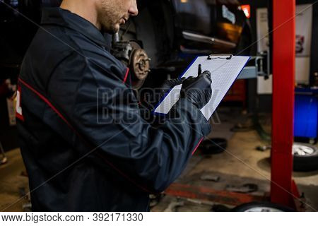 Car Mechanic Portrait. Caucasian Auto Service Worker In His 30s.