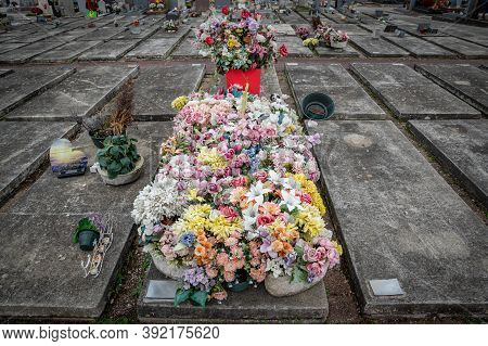 Lyon, Rhone Alpes Auvergne, October 29 2020 : Ornate Cemetery With Multicolor Flowers At Toussaint D