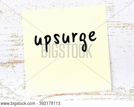 Yellow Sticky Note On Wooden Wall With Handwritten Inscription Upsurge