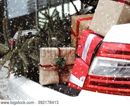 Car With Trunk Full Of Gift Boxes, Presents And Fir Tree For Christmas. Car, Presents, Craft Box, Sn