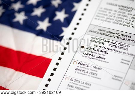 Riverside, California, USA - 10/2020: Biden Voted Bubble on Official Ballot Over American Flag in the 2020 Presidential Election.