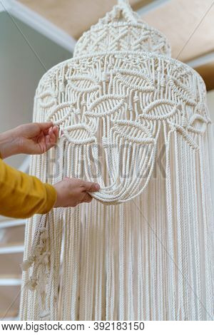 Freelancer Woman Working On Half-finished Macrame Piece, Weaves Lamp Shade For Chandelier. Women Hob
