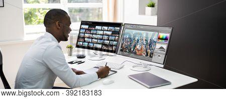 African Graphic Web Designer Using Design Editing Software