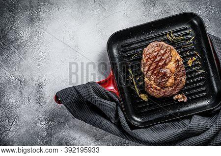 Grilled Rib Eye, Ribeye Steak In A Pan. Gray Background. Top View. Copy Space
