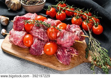 Raw Fresh Shish Kebab. Bbq Meat With Tomato And . Gray Background. Top View