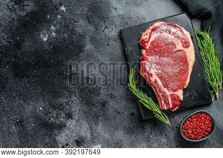 Rib Eye Or Cowboy Steak. Raw Marble Beef Black Angus, Ribeye. Back Background. Top View. Copy Space