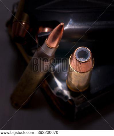 A Loaded Handgun Magazine With 40 Caliber Bullets And A Loaded Rifle Magazine With .223 Caliber Bull