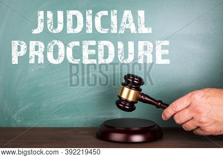 Judicial Procedure. Law And Legal Concept. Judges Hammer And A Green Chalkboard