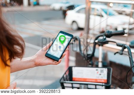 Internet Navigation. A Woman Holds A Smartphone With An Online Map In Her Hand. In The Background, A