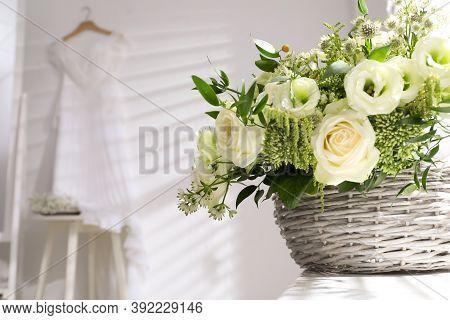 Basket With Beautiful Wedding Flowers On Window Sill Indoors, Closeup