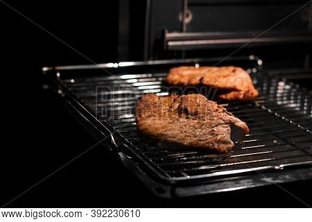 Juicy Meat On The Grill In The Oven.