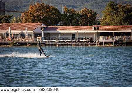 Man Being Pulled On A Wakeboard On A Lake