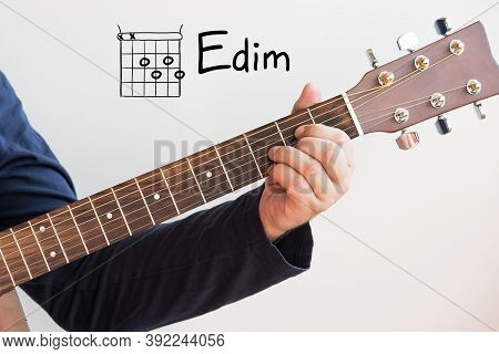 Learn Guitar - Man In A Dark Blue Shirt Playing Guitar Chords Displayed On Whiteboard, Chord E Dim