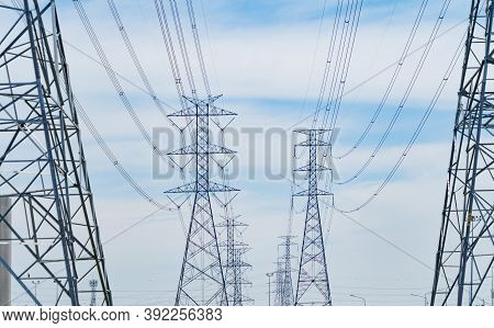 High Voltage Poles. Power Lines On Utility Tower And Cable Wires In Energy Electric Technology, Netw