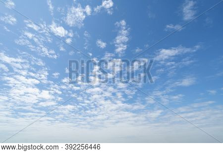 Clear Blue Sky With White Fluffy Clouds At Noon. Day Time. Abstract Nature Landscape Background.