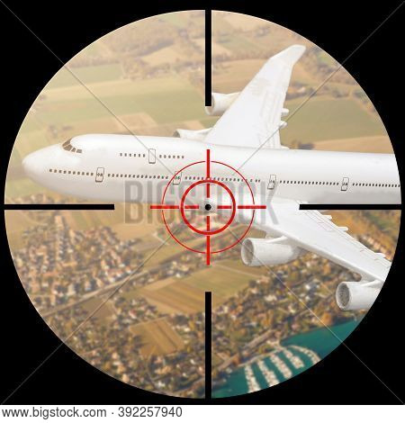 Airplane In The Sight Of Anti-aircraft Weapons. Missile Defense System Aimed At Passenger Plane In T