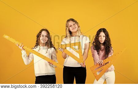 Students Preparing To The Exams. Sisterhood. Three Girls With Triangle And Ruler. Back To School. St