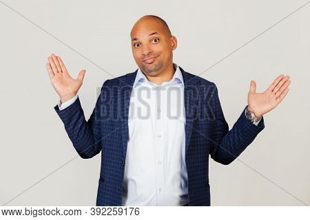 Portrait Of Doubtful Young African American Businessman Guy, Gesturing With Hands, Ignorant And Conf