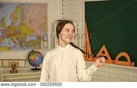 Happy Schoolgirl. Little Schoolgirl Back To School. Small Schoolgirl Wear School Uniform. Cute Smili