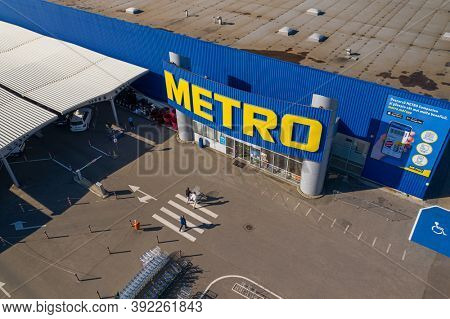 Chisinau, Moldova - October, 2020: Metro retail store, large shopping mall of household and food goods with parking, aerial view, copyspace