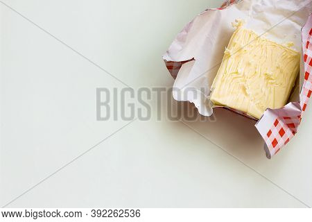 Butter In Unfolded Packaging On A Light Background, Healthy Fats, Dairy Product, Copy Space For Text