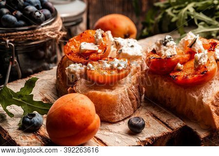 Healthy Summer Appetizer Or Snack Toast With Soft Dor Blue Cheese, Fresh Juicy Peach, Blueberry And