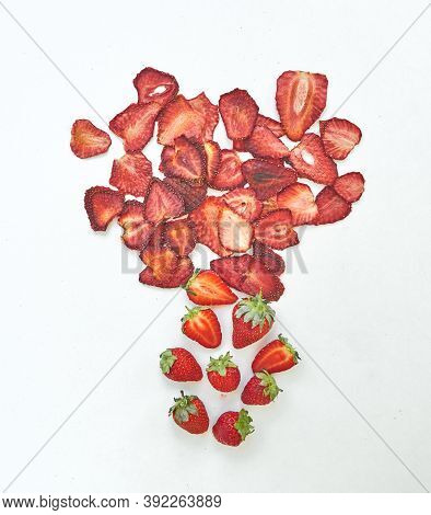 Flat Lay Composition With Fresh And Dried Strawberries Slices On White Background.