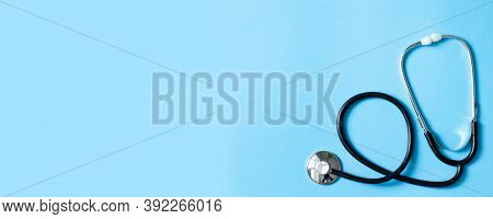 Medical Stethoscope On Blue Background. Flat Lay, Top View, Copy Space. Medical And Health Care Conc