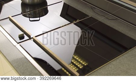 Close Up Of Functional Kitchen Induction Hob In A New Flat. Household Utensils. Details Of Interior,