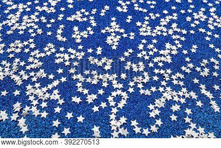 Scattered Stars On A Shiny Blue Festive Background.
