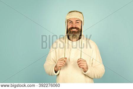 Bearded Man Wear Hat With Ear Flaps. Furry Accessory. Fur Garments. Bearded Hipster. Winter Fashion.