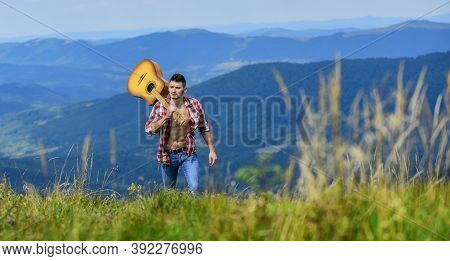 Peaceful Hiker. Carefree Wanderer. Vast Expanses. Conquer The Peaks. Man Hiker With Guitar Walking O