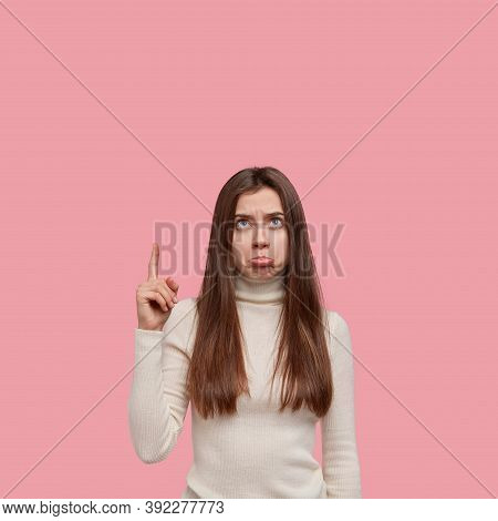 Negative Human Facial Expressions Concept. Dissatisfied Lady Has Dejected Look, Purses Lower Lip As