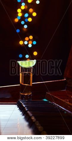 Glass With Tequila On A Piano