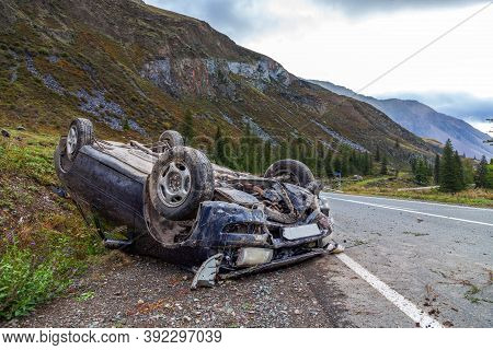 Crushed Car Accident Place On A Bend