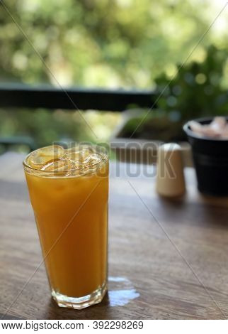 Fresh Orange Juice With Ice In A Glass Glass On A Summer Veranda In A Cafe