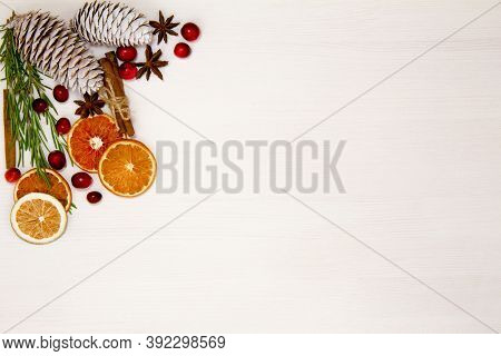 Christmas Food On A White Background. Ingredients For Cooking - Cranberries, Rosemary, Orange And An