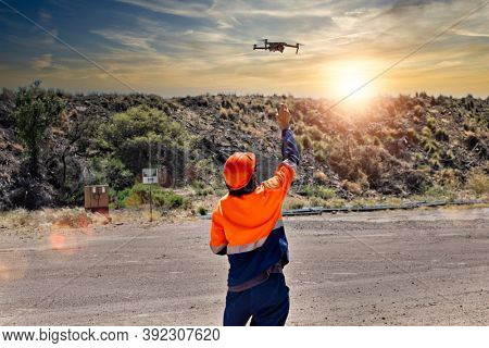 pilot catching a drone on site at a diamond mine