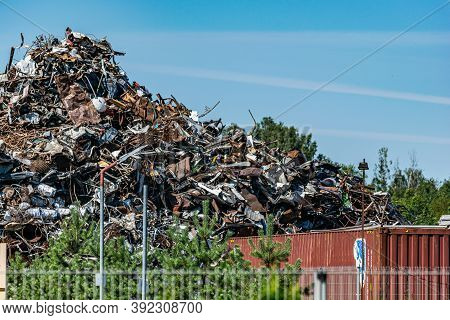 Landfill Against The Sky. A Large Pile Of Collected Scrap Metal On The Territory Of The Metal Collec