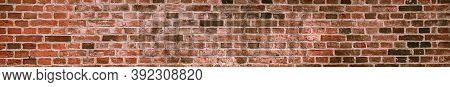 Panorama Of A Soiled Dirty Red Brick Wall. Old Dilapidated Brick Wall Surface.