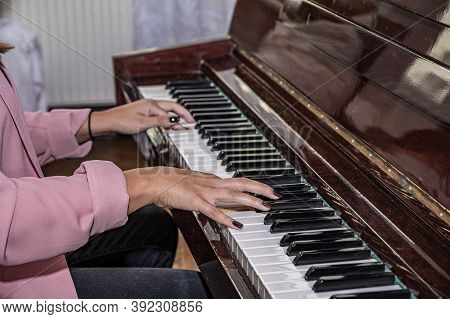 Close Up Of Woman Hands Classic Piano Playing. Teen Woman Relaxing And Playing The Piano In The Livi