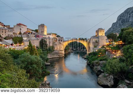 Stari Most bridge at twilight in old town of Mostar, Bosnia and Herzegovina. Mostar cityscape at summer