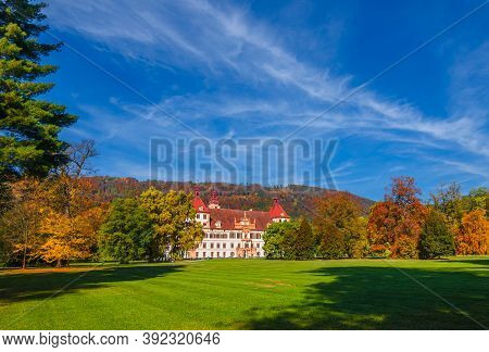 Graz, Austria-october 14, 2019: Eggenberg Palace And Colorful Autumn Colors In The Park, Famous Tour