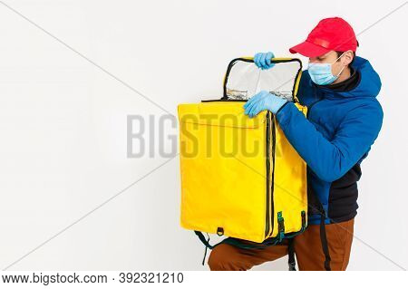 Delivery Man Send Food Bag At Door Knob For Contactless Or Contact Free From Delivery Rider In Front