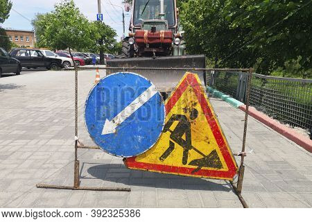 Road Repair, Road Sign And Road Repair Equipment. Road Works Traffic Sign At The City Street. Roadwo
