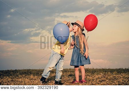 Kids Having Fun In Green Field Against Sky. Valentines Day Cupid Child. Happy Valentines Day. Love C