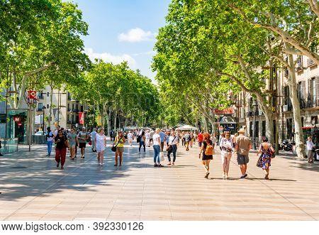 Barcelona, Spain - June 2019: People On La Rambla (central Street Of Barcelona)